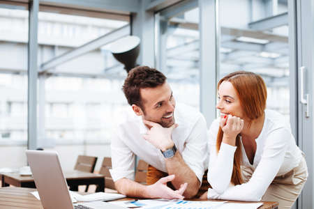 Foto de Two business people working at office - Imagen libre de derechos