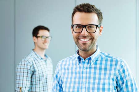 Foto de Two computer geeks standing in office - Imagen libre de derechos