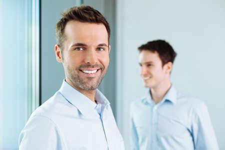 Foto de Two happy business partners standing in office - Imagen libre de derechos