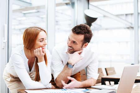 Foto de Happy business people discuss financial data at office - Imagen libre de derechos