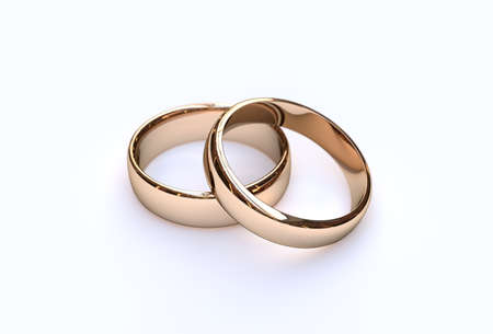 Foto de Golden wedding rings on white background, close up - Imagen libre de derechos