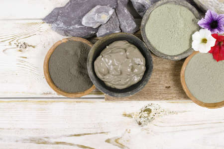 Photo pour Ancient minerals - green and blue clay powder and mud mask for spa, beauty concept - image libre de droit