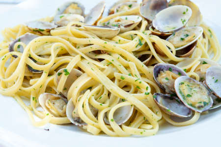 Photo for Traditional Italian seafood, spaghetti vongole made with seashells and linguini pasta - Royalty Free Image