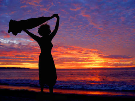 Photo for Woman on the beach at sunset - Royalty Free Image