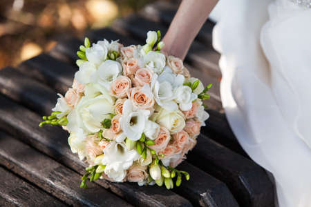 Foto de Beautiful wedding bouquet in hands - Imagen libre de derechos