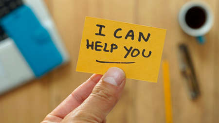 Photo for I can help you written on a card at the office - Royalty Free Image
