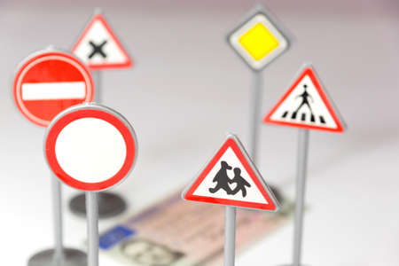 Photo for Driver's license and various traffic signs - Royalty Free Image