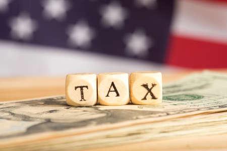Photo pour Money dollars, american flag and taxes - image libre de droit