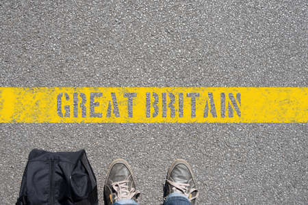 Photo for A man with a suitcase is on the border with Great Britain - Royalty Free Image