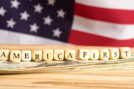 Foto per American flag, dollar bills and slogan America First - Immagine Royalty Free