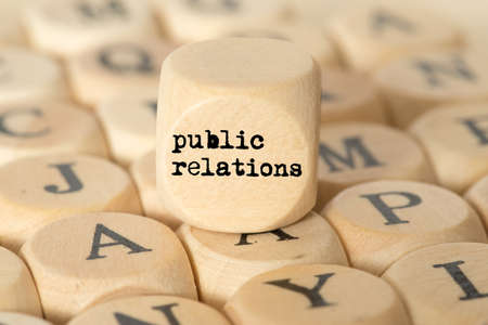 Photo for Different letters and a cube with the term Public Relations - Royalty Free Image