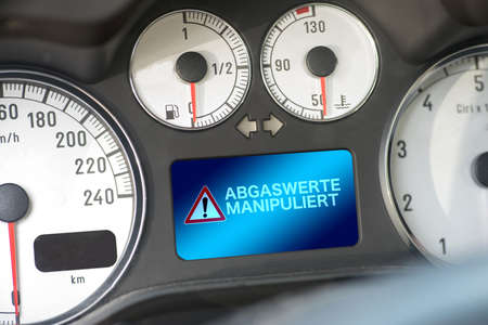 Foto de Interior of a car and warning of exhaust emissions manipulation - Imagen libre de derechos