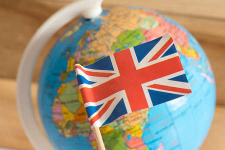 Photo for Flag of Great Britain and a globe in the background - Royalty Free Image