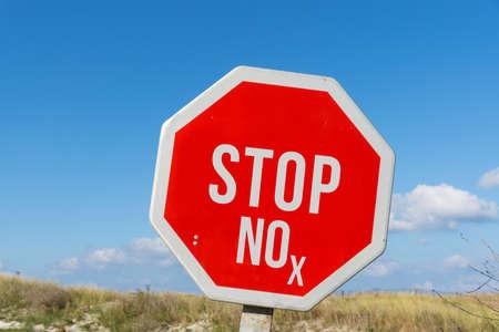 Photo pour A stop sign and the abbreviation NOx for nitrogen dioxide - image libre de droit