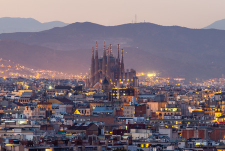 Foto de Panorama view of barcelona city and sagrada familia at dusk time,Spain - Imagen libre de derechos