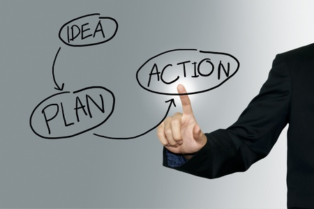 Photo pour Business man pointing business plan on the screen background - image libre de droit