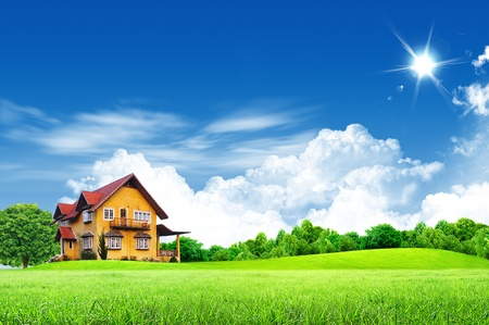 Photo pour House on green field landscape with blue sky - image libre de droit