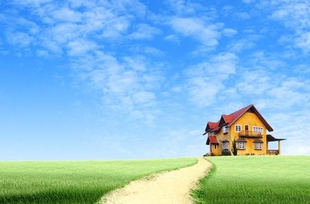 Photo pour Road to House on green field landscape with blue sky - image libre de droit