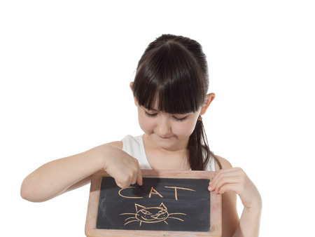 Young caucasian girl holding chalkboard signed cat isolated on white