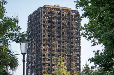 Photo pour Charred remains of the Grenfell Tower block of council flats in which at least 80 people are feared to have died in a fire, Kensington, West London. - image libre de droit