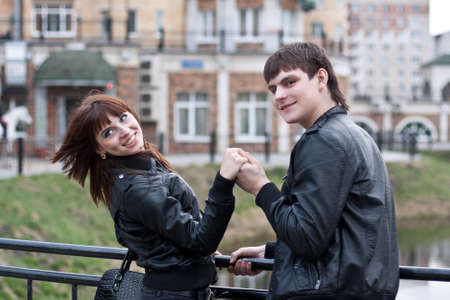 Picture of beautiful young laughing couple outdoors