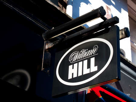 Photo pour William Hill bookmakers sign, company founded by William Hill in 1934 at a time when gambling was illegal in Britain - image libre de droit