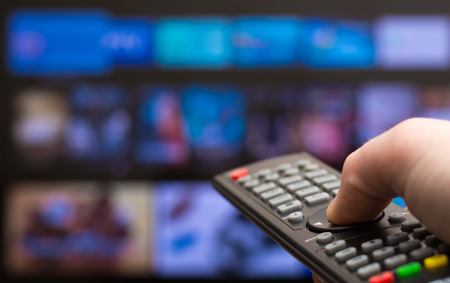 Photo for TV remote in hand - Royalty Free Image