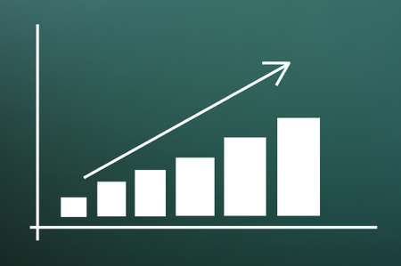 Business chart of growth drawn on a blackboard background