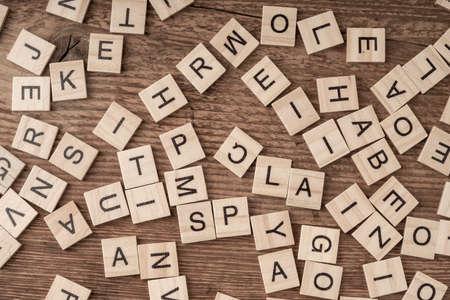 Photo pour cube letters on a wooden table as a background - image libre de droit