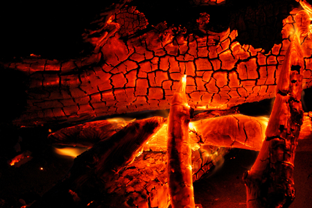 Photo for Burning log of wood close-up as abstract background. The hot embers of burning wood log fire. Firewood burning on grill. Texture fire bonfire embers. Smoldering fire. - Royalty Free Image