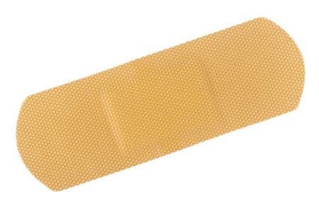Foto de Top view of  beige adhesive bandage isolated on white - Imagen libre de derechos