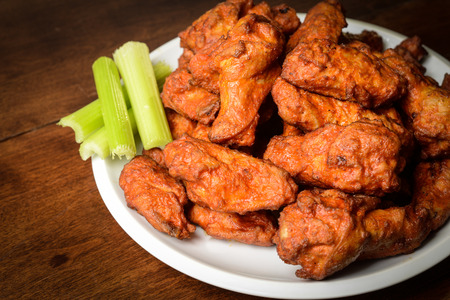 Photo for Chicken Buffalo Wings with Celery Sticks - Royalty Free Image