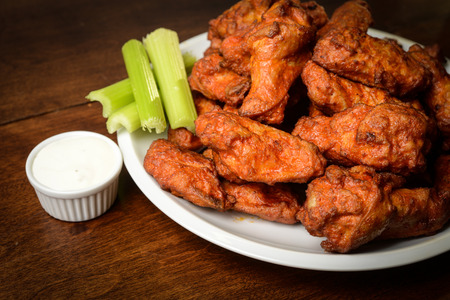 Photo for Chicken Buffalo Wings with Celery Sticks and Blue Cheese Dressing - Royalty Free Image
