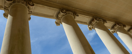 Photo for Pillars of Law and Justice with Blue Sky - Royalty Free Image