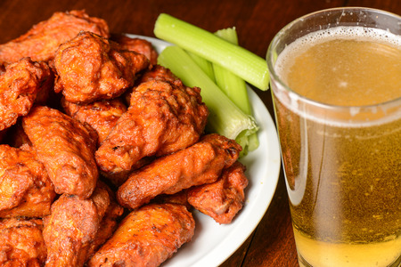 Photo for Buffalo Wings with Celery Sticks and Beer - Royalty Free Image