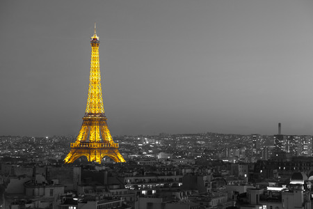 Photo pour Paris, France - October 18 2014: Aerial view on illuminated Eiffel Tower with city on background, black and white effect applied - image libre de droit
