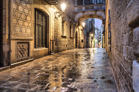 Photo for Narrow street Carrer del Bisbe in gothic quarter, Barcelona, Spain - Royalty Free Image