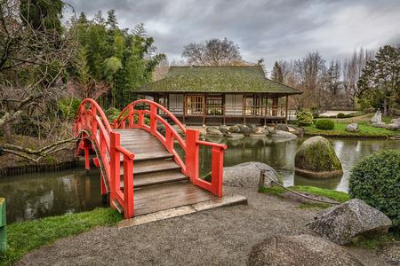 Photo pour Red arch bridge in public japanese garden in Toulouse, France - image libre de droit