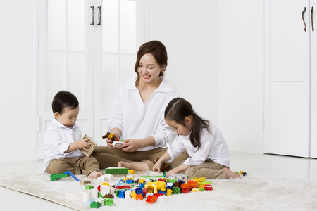 Photo for Asian Mother and Daughter Playing with Building Blocks at Home - Royalty Free Image