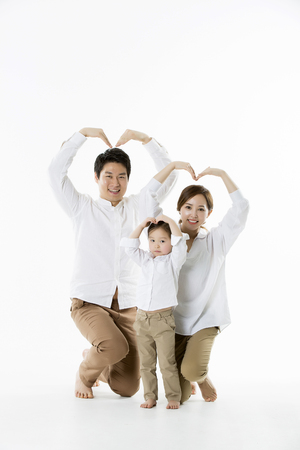 Photo for Happy Asian Family Posing,Making Heart Sign with Arms - Isolated on White - Royalty Free Image