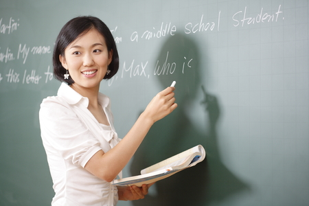 Photo pour A teacher posing in a high school classroom - image libre de droit