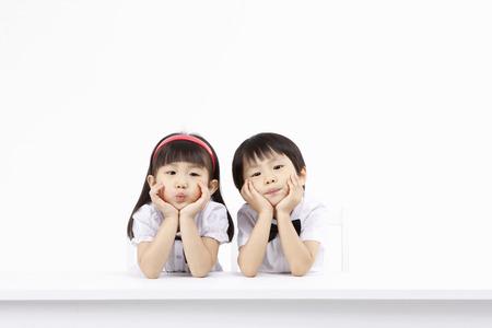 Foto de Asian kids with education concept- Isolated on studio shot - Imagen libre de derechos