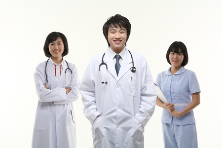 Photo for Two doctors and a nurse standing with toothy smile - Royalty Free Image