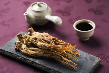 Photo for dried ginseng,on a Korean traditional roof tile and red ginseng extract - Royalty Free Image