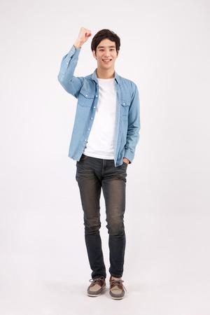 Foto de Portrait of Asian young man giving cheers isolated on white - Imagen libre de derechos