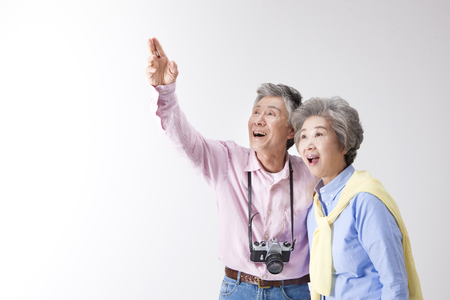 Foto de Asian old aged couple with camera isolated on white - Imagen libre de derechos