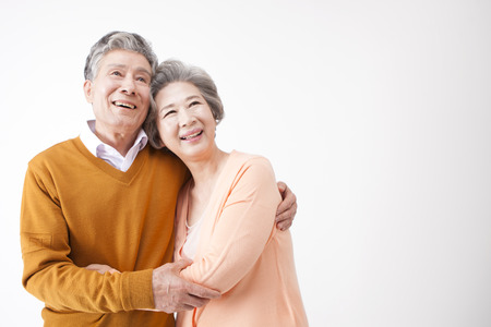 Photo pour Asian old aged couple having good time isolated on white - image libre de droit
