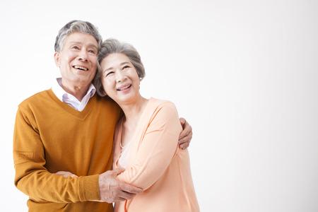 Foto de Asian old aged couple having good time isolated on white - Imagen libre de derechos