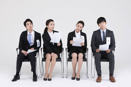 Photo pour Asian people waiting for job interview isolated on white - image libre de droit