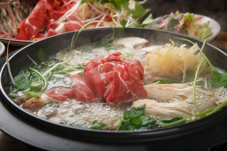 Photo pour Shabu-shabu, hotpot with mushroom, chives, bok choy, vegetables and beef in pot - image libre de droit